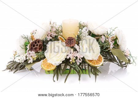 composition of flowers and candles to decorate a home fireplace