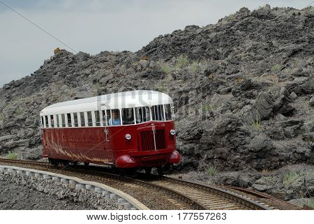 Catania Italy - June 03 2008: Tourist railway Circumetnea. The historic train Fiat named Littorina that travels around the Etna volcano in the middle of the lava.