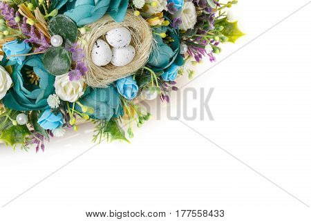 beautiful decorative basket with flowers to celebrate Easter on a white background, place for text