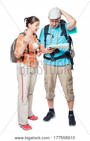 Two Lost Tourists Look At The Map On A White Background In The Studio