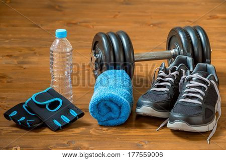 Set Of Sports Facilities For A Male Athlete On A Wooden Floor