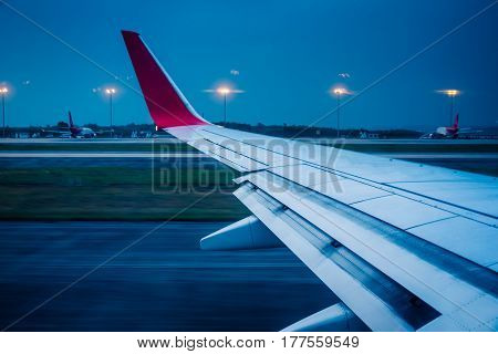 View of air plane wing during take off or landingtravel concept.