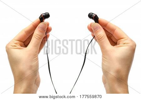 Hand Of Young Girl Holding Earphones.