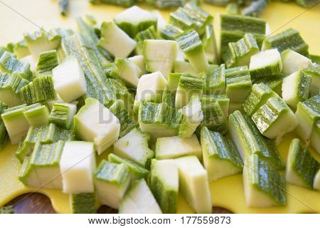 zucchini clipped in chunks as ingredient for seasoning of the pasta