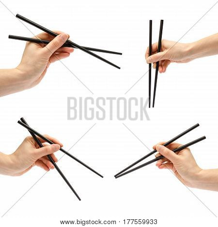 Hand Of Young Girl Holding Sushi Sticks