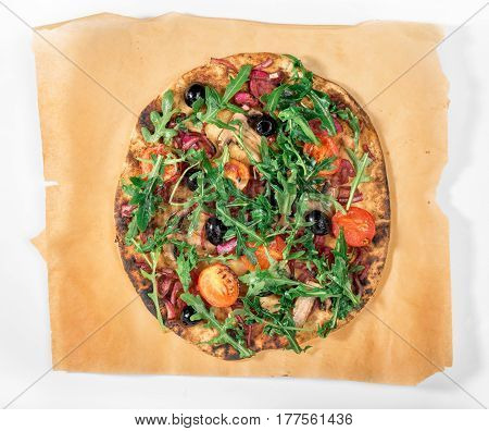 Vegan pizza with mushrooms tomatoes marinated red onion and arugula on white background top view