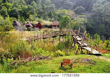 Amazing Wooden Bridge Leading To Scenic Rustic Houses