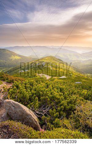 sunrise on a mountaintop. magic morning sky with the sun