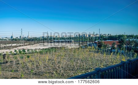 Beijng, China - Oct 31, 2016: Countryside scene just outside Beijing. Captured from within a High-Speed Rail (HSR), scene shows some plant regeneration work in the foreground.