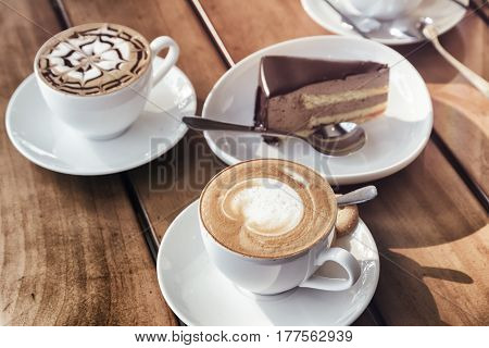 Cups Of Cappuccino Coffee And Chocolate Mousse Cake. Toned Image