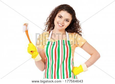 Smiling young woman holding tools for cleaning house  on white background. Cleaning concept. Housekeeper isolated portrait.
