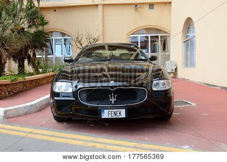 MALTA - APRIL 20: The luxury Maserati Quattroporte car is near luxurious hotel on April 20 2015 in Malta. More then 16 mln tourists is expected to visit Malta in year 2015.