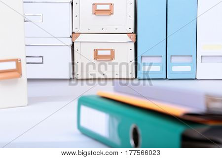 Folder file and note on the desk. blurred background