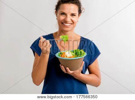 Portrait of a middle aged woman eating a healthy salade