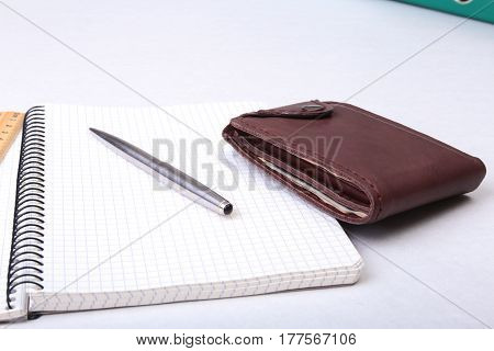 leather wallet with credit cards, Folder file, and note on the desk. blurred background