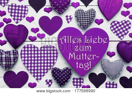 Purple Heart Texture With German Text Alles Liebe Zum Muttertag Means Happy Mothers Day. White Wooden Background. Textile Hearts Which Are Dotted and Striped. Greeting Card