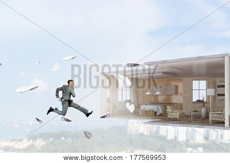 Jumping businessman in office. Mixed media . Mixed media