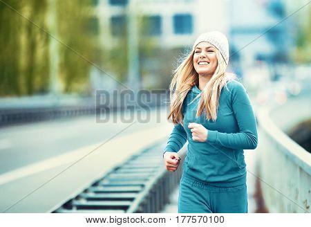 Woman Exercising On Bridge