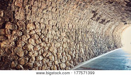 Old tunnel through mountains  Herzeg Novi Embankment Montenegro Adriatik  sea.