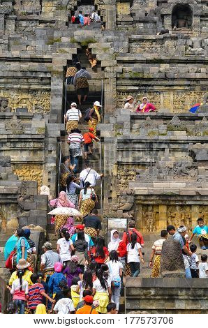 Magelang, Central Java, Indonesia - Circa January 2012 - Tourists and visitors climbing steps of Borobudur