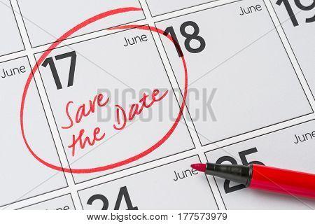 Save The Date Written On A Calendar - June 17