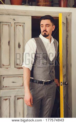 Elegant groom wearing white shirt and vest