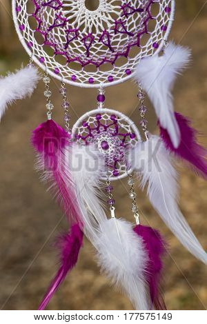 Red black and purple Dreamcatcher with bat made of feathers leather beads and ropes hanging