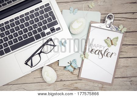 Easter Background With Eastereggs And Butterflies On Wood