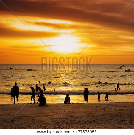 Group Of People On Sunset Beach