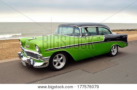 FELIXSTOWE, SUFFOLK, ENGLAND - AUGUST 27, 2016: Classic Green and Black Chevrolet Belair Automobile  parked on seafront promenade.