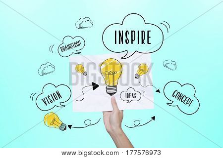 hand holding paper with lightbulb. concept for new ideas with innovation and creativity.
