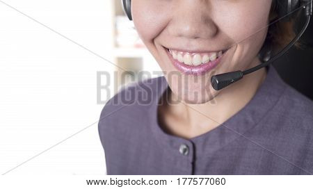 Asia women happy smiling customer support operator with headset in office.