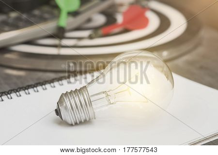 lightbulb on paper book. concept for new ideas with innovation and creativity.