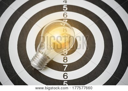 lightbulb on dartboard. concept goal for new ideas with innovation and creativity.