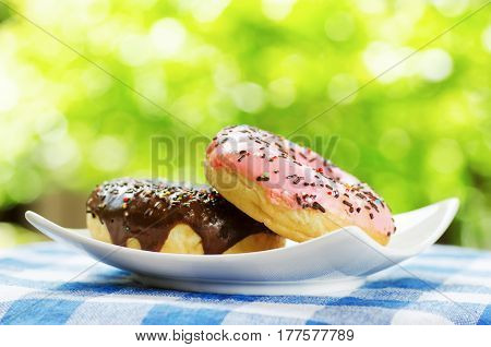 Fresh Donuts On Nature Background