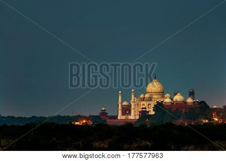 Agra, India at sunset. Taj Mahal in Agra, India at night with colorful dark sunset sky