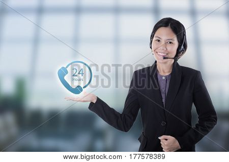 Asia women happy smiling customer support operator with headset 24 hours in office.