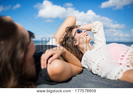 Beautiful Woman Lying On Beach With Friend Laughing