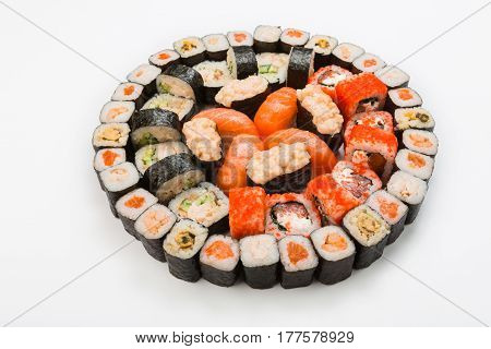 Sushi and rolls - japanese food restaurant delivery, salmon platter set isolated at white background, placed in circle