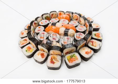 Sushi, maki and rolls - japanese food restaurant delivery, platter set isolated at white background, placed in circle