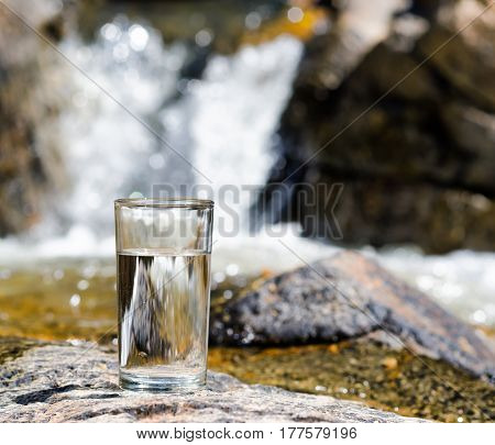 Glass Of Water By Waterfall
