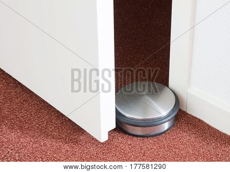 Dusty Doorstop In A Modern House