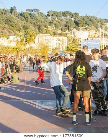 Nice, France - 25 February, Active entertainment of young people, 25 February, 2017. People and tourists having a rest on the Cote d'Azur.