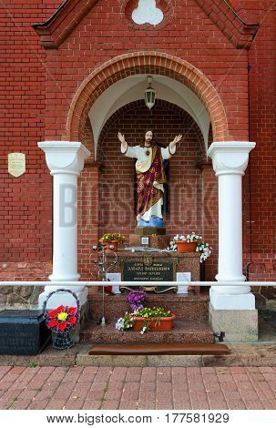 MINSK BELARUS - OCTOBER 1 2016: Monument to Edward Voinilovich founder of catholic church of St. Simeon and St. Helena (Red Catholic Church) Minsk Belarus