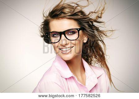 Close-up portrait of a gorgeous young woman wearing glasses. Beauty, fashion. Make-up. Optics, eyewear.