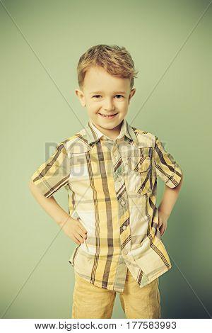 Portrait of a cute laughing little boy. Copy space. Children fashion, summer concept. Sepia.