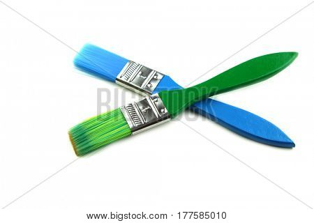 Two one inch paint brushes isolated on white background