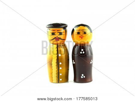 Two wooden Indian dolls on white background