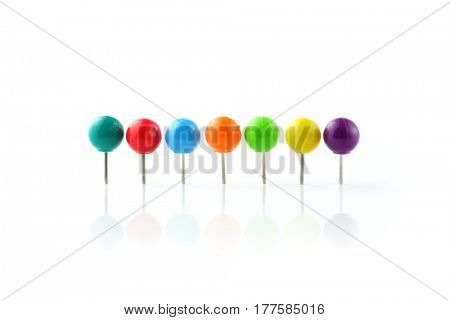 Row of colorful push pins