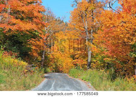 Drive through rural Vermont in fall foliage